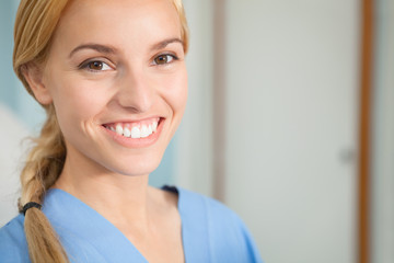 Close up of a nurse looking at camera while smiling