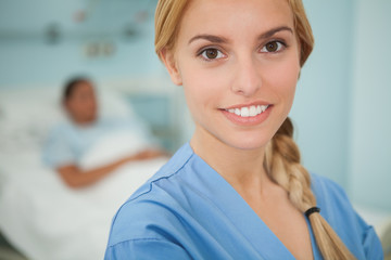 Close up of a blonde nurse smiling