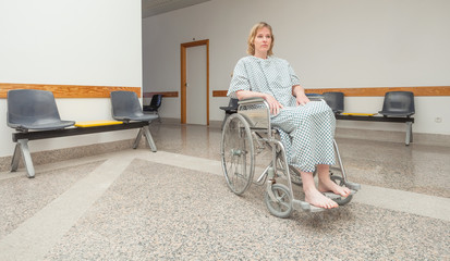 Patient sitting on a wheelchair