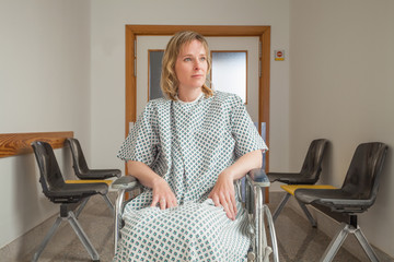 Thoughtful patient sitting on a wheelchair