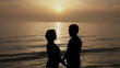 Couple kissing at sunset on the seashore