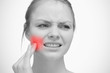 Woman touching red highlighted toothache
