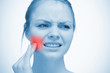 Woman touching highlighted red toothache