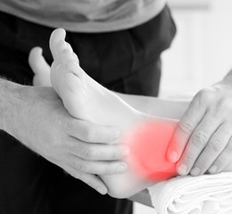 Physiotherapist working on patients highlighted ankle