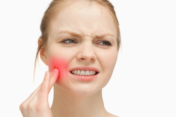 Woman touching highlighted toothache