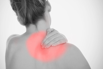Woman rubbing shoulder pain