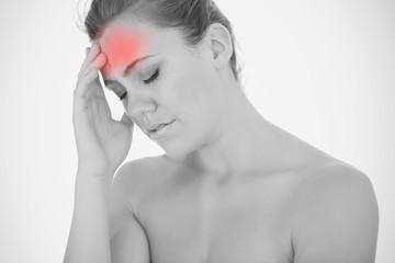 Woman touching head in pain