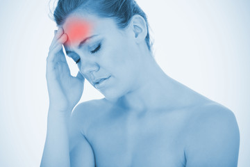 Stressed woman touching head in pain