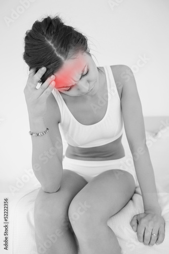Woman rubbing her head with highlighted pain