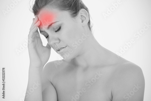 Woman touching head in pain