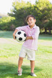 Boy posing with his football