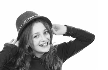 Young girl smiling and putting on her hat