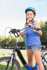 Portrait of smiling girl with her bike