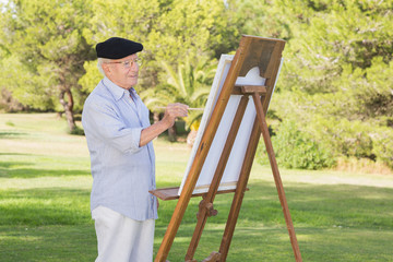 Old man painting in the park