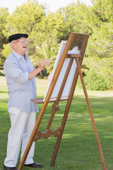 Old man painting outside
