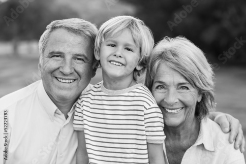 Black and white portrait of grandparents with grandson
