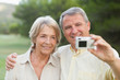 Couple taking a photo of themselves and smiling