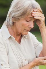 Older woman getting a headache