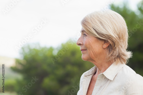 Thoughtful older woman looking into the distance