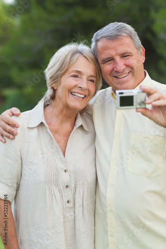 Older couple smiling for a photo