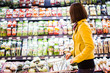 Young woman shopping in the supermarket