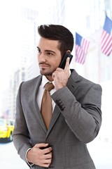 Businessman on the call outdoors