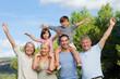 Multi-generation family portrait cheering and having fun