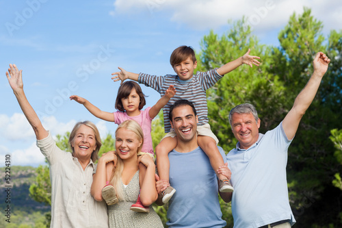 Multi-generation family portrait cheering and having fun