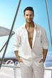 Summer portrait of handsome man on sailing boat