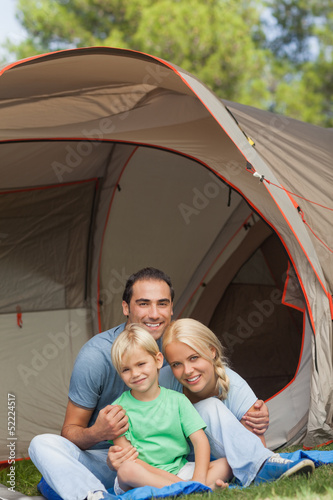 Portrait of son with parents on camping holiday
