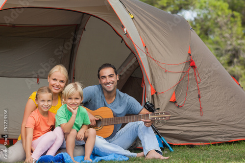Portrait of happy family at the campsite