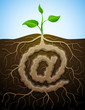 "Vector concept of germination ""at"" symbol with roots and tuber"