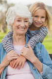 Elderly woman posing with her cute granddaughter