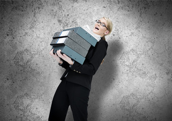 Businesswoman struggling with work load