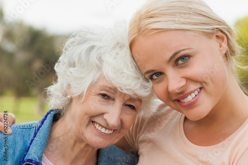 Portrait of elderly mother with adult daughter