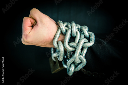 Hand wrapped in chain and lock