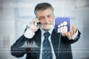 Businessman selecting social network application from touchscreen