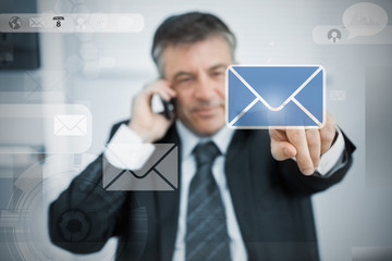 Businessman selecting email application on touchscreen