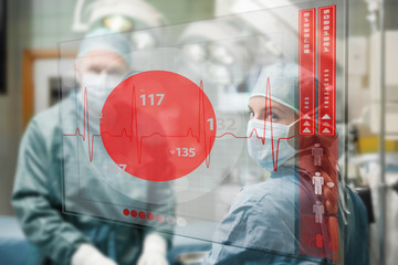 Surgeons checking holographic heart rate display
