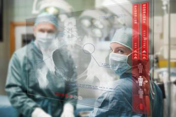 Surgeons checking holographic x-ray display
