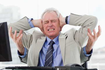 Stressed businessman with four arms