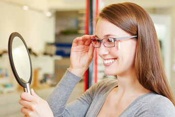 Young woman checking her new glasses