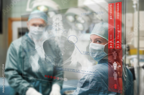 Surgeons checking holographic x-ray display