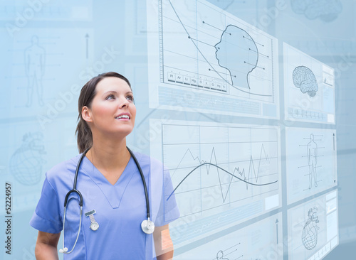 Nurse observing graphics on screen