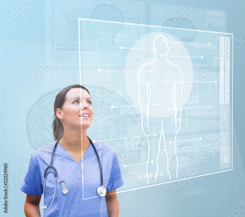 Nurse looking up to interface showing human form