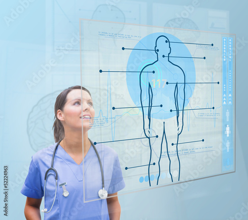 Nurse looking up to screen showing human form