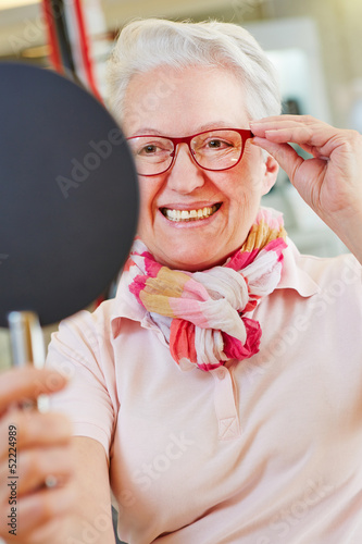 Nearsighted senior woman with new glasses