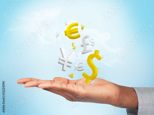 Businessman with currencies in his hand