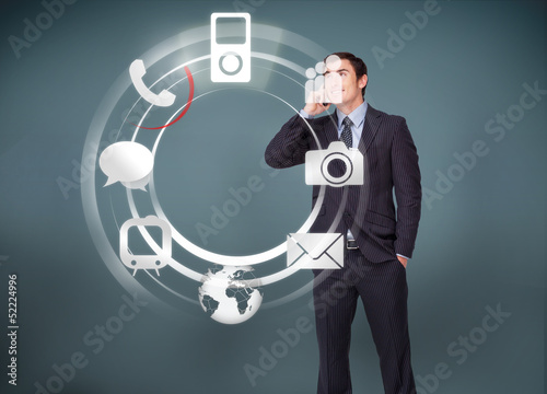 Businessman on the phone looking at wheel of applications