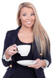 Happy blond woman drinking from a white cup